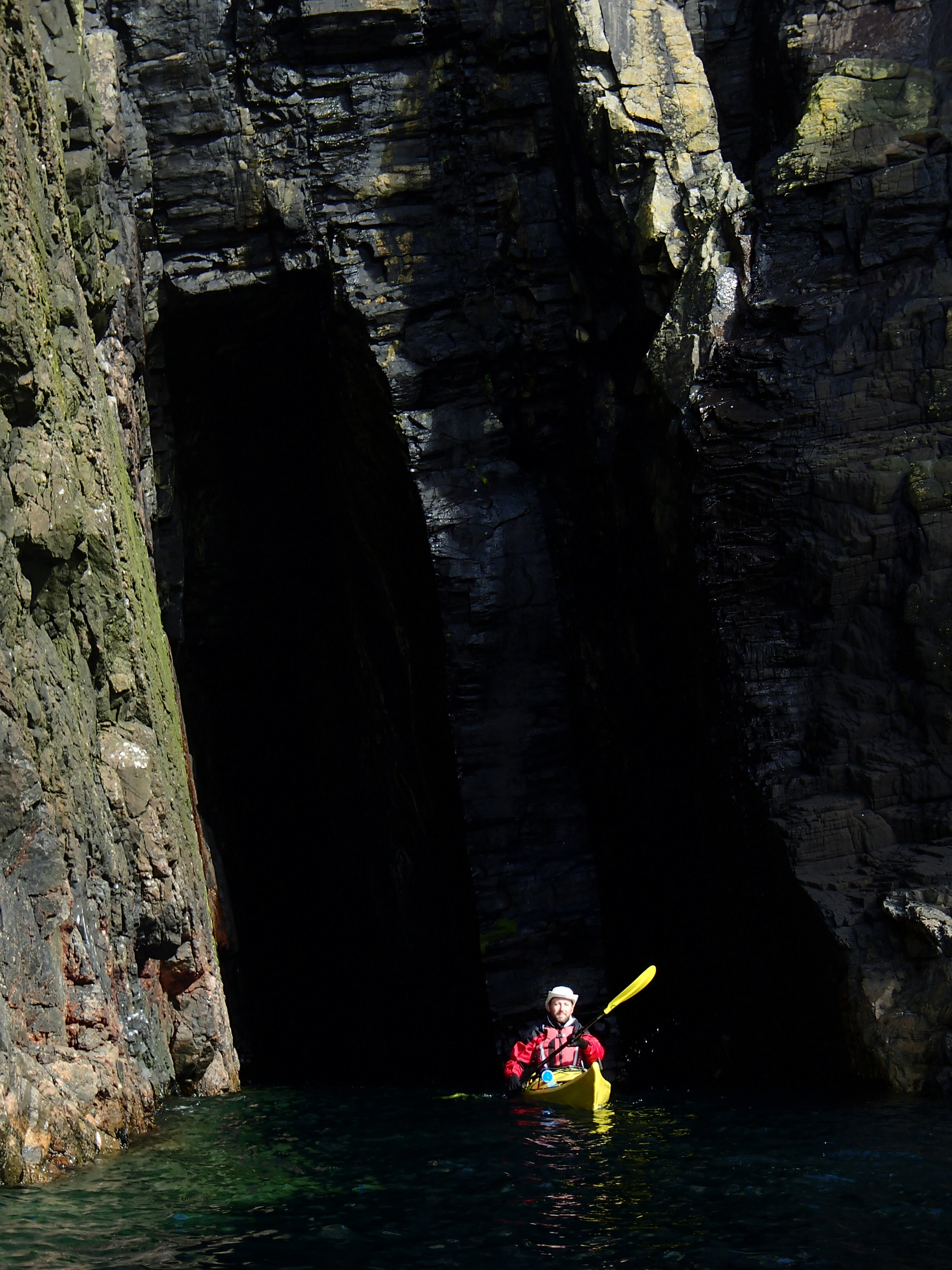sea kayak exploring caves