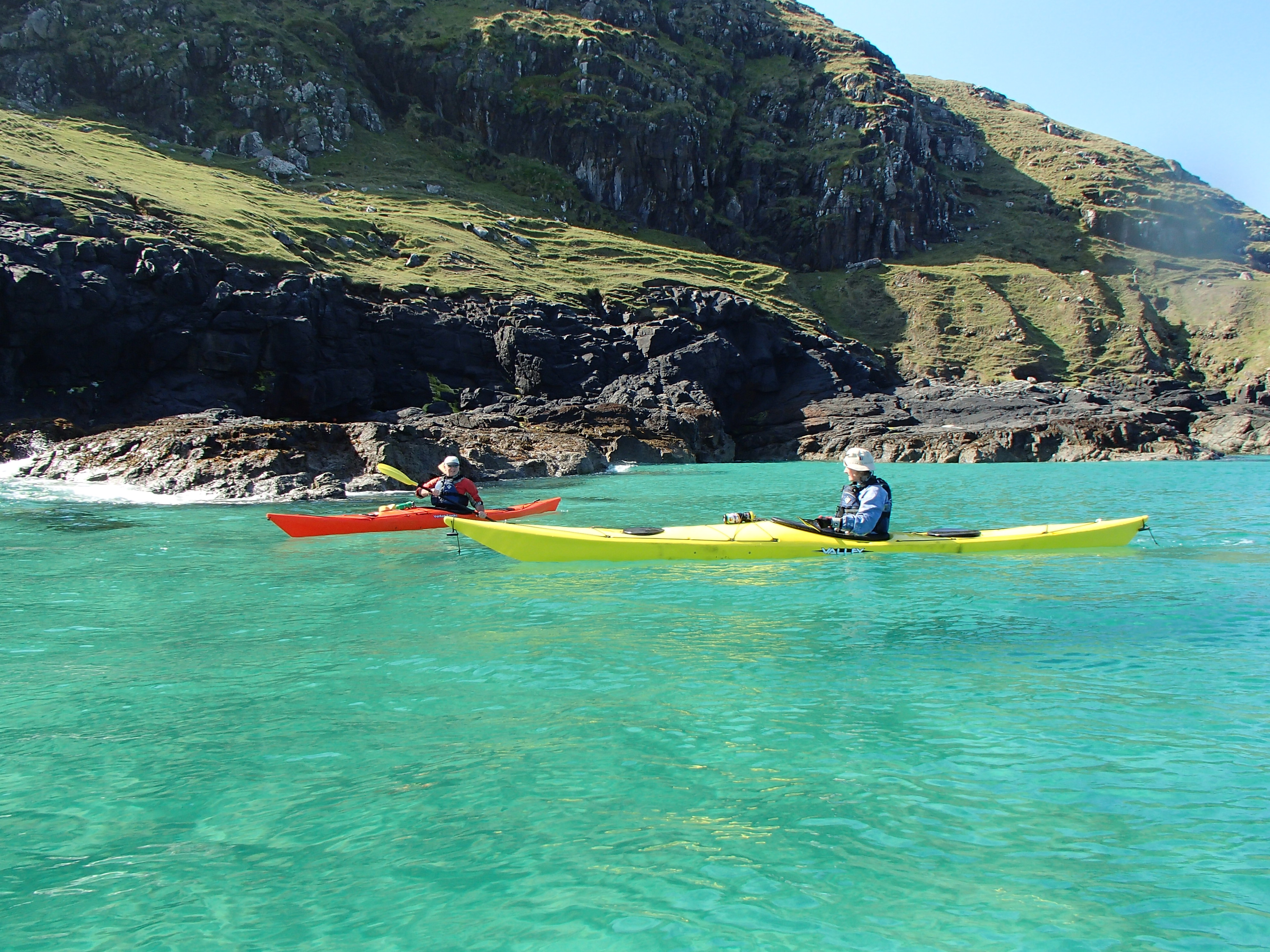 sea kayaks on fantastic clear ocean