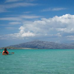 sea kayak and tropical-looking sea in Scotland