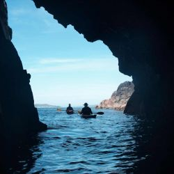 kayaks in a sea cave