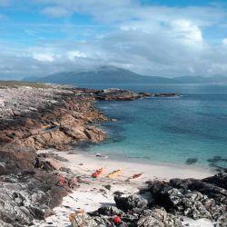 kayaks on a rugged island beach