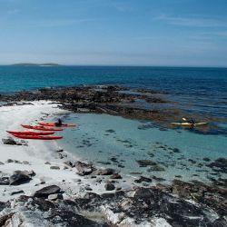 kayaks on an empty beach