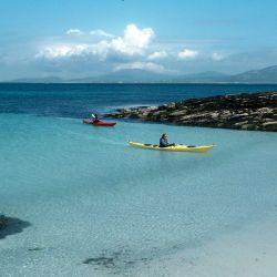 clear waters, turquoise sea and kayakers