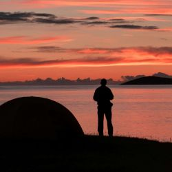 watching the sunset from tent