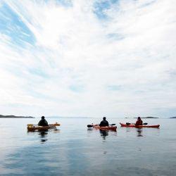 kayaks on mirror calm ocean