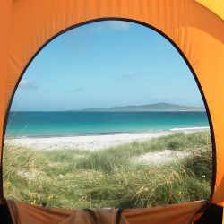 view of the beach from a tent