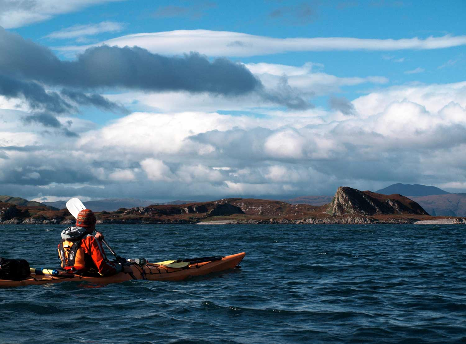 sea kayaker in stunning Hebrides scenery