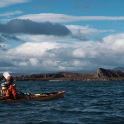 sea kayaker in stunning Hebrides scenery